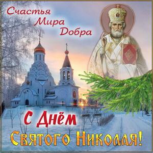 Храм зимой и икона Святого Николая на красивом фоне