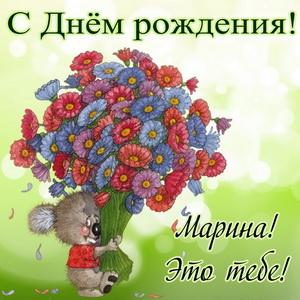 Мультяшный медвежонок с огромным букетом цветов
