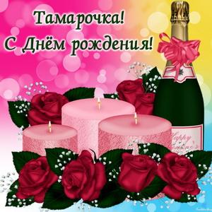 Открытка с шампанским среди роз и свечей
